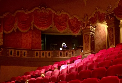 Color photograph of interior of a theatre.